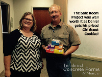 Daniel Keeslar gets his prized Girl Scout Cookies from the Girl Scouts of Western Oklahoma for their Quad-Lock ICF Safe Room